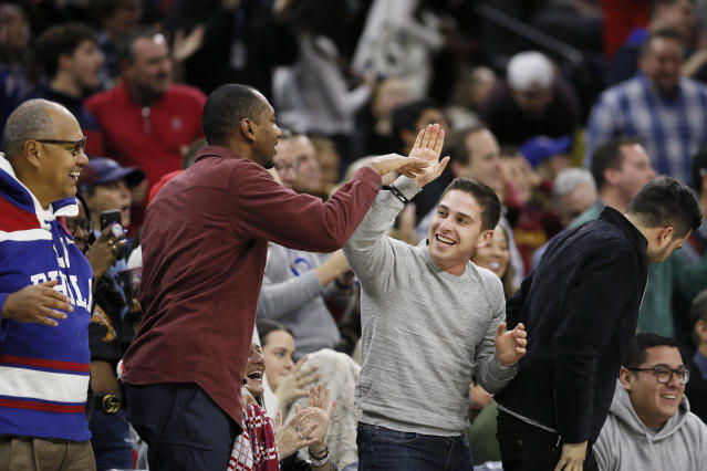 Fans celebrate after Philadelphia 76ers' Ben Simmons made a three-point basket during the first half of an NBA basketball game against the Cleveland Cavaliers, Saturday, Dec. 7, 2019, in Philadelphia. (AP Photo/Matt Slocum)