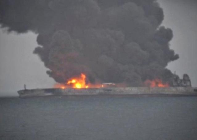 <p>Smoke and fire is seen from Panama-registered tanker Sanchi carrying Iranian oil after it collided with a Chinese freight ship in the East China Sea, in this still image taken from a Jan. 7, 2018 video.(Photo: China Daily via Reuters) </p>