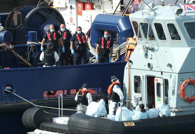 A Border Force vessel brings a group of people thought to be migrants into Dover, Kent