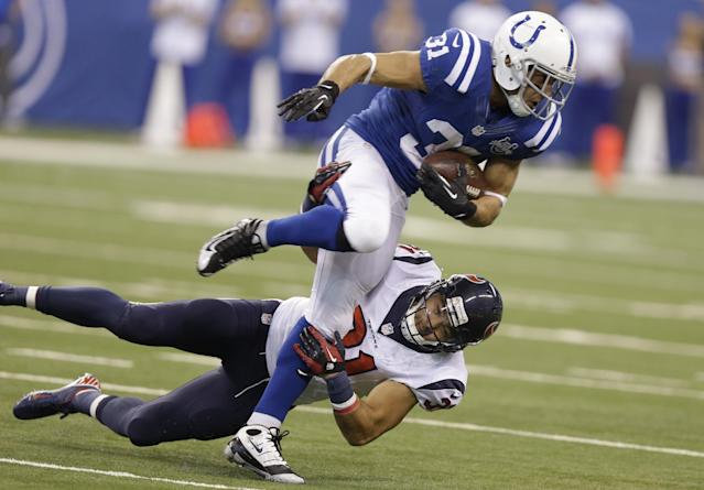 Indianapolis Colts running back Donald Brown, top, is tackled by Houston Texans free safety Shiloh Keo during the first half of an NFL football game in Indianapolis, Sunday, Dec. 15, 2013. (AP Photo/Michael Conroy)