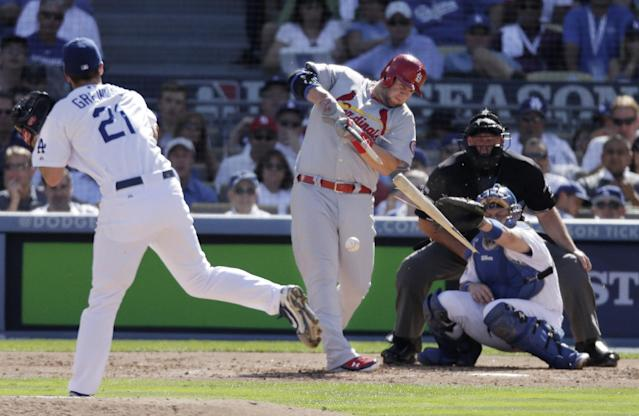 St. Louis Cardinals' Matt Adams hits a broken-bat single during the third inning of Game 5 of the National League baseball championship series against the Los Angeles Dodgers Wednesday, Oct. 16, 2013, in Los Angeles. (AP Photo/Chris Carlson)