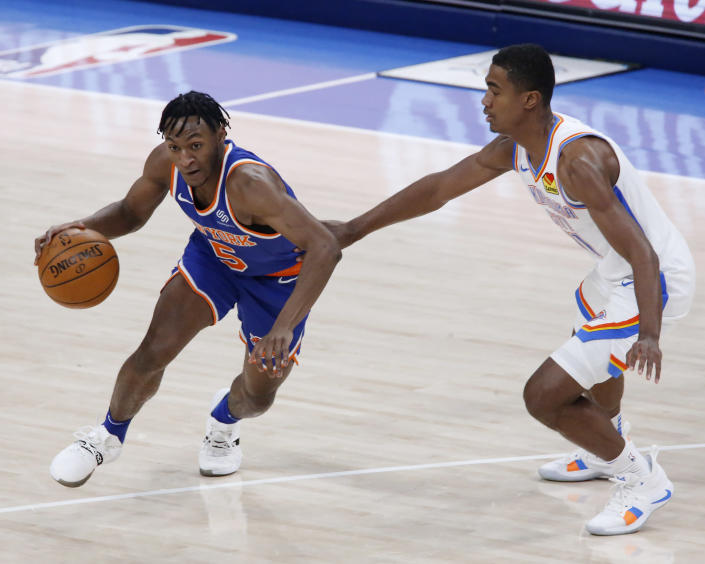New York Knicks guard Immanuel Quickley (5) drives the ball against Oklahoma City Thunder guard Theo Maledon (11) during the second half of an NBA basketball game, Saturday, March 13, 2021, in Oklahoma City. (AP Photo/Garett Fisbeck)