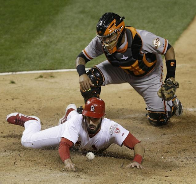San Francisco Giants catcher Hector Sanchez can't handle the throw as St. Louis Cardinals' Matt Carpenter scores from second on a single by Matt Holliday during the fifth inning of Game 4 of baseball's National League championship series Thursday, Oct. 18, 2012, in St. Louis. (AP Photo/Patrick Semansky)