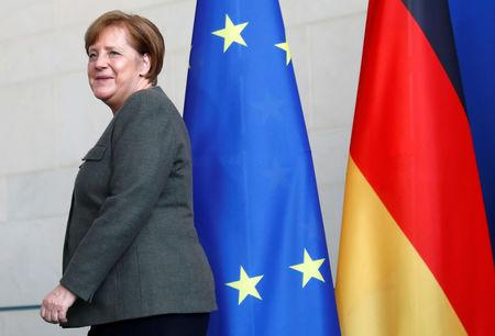 German Chancellor Angela Merkel leaves a news conference at the Chancellery in Berlin