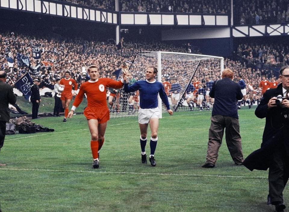Roger Hunt and Ray Wilson parade the World Cup around Goodison Park before the 1966 Charity Shield.