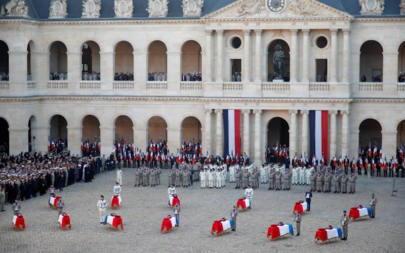 France pays tribute to 13 French soldiers who died in a helicopter accident in Mali - REUTERS