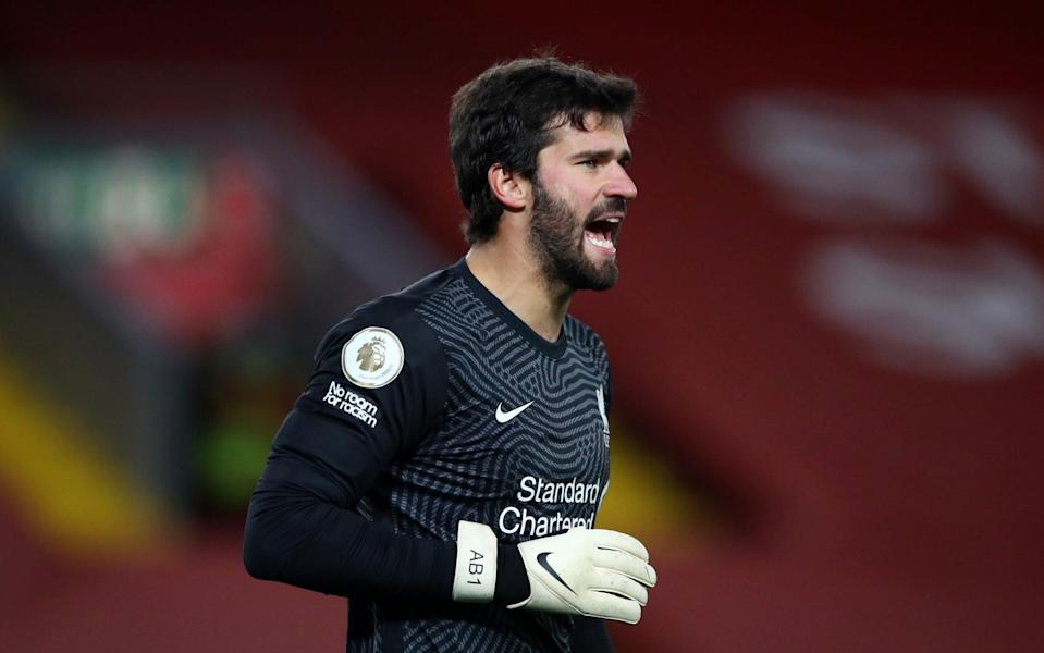 Alisson Becker of Liverpool gives his team instructions during the Premier League match between Liverpool and Sheffield United at Anfield on October 24, 2020 in Liverpool, England. - GETTY IMAGES