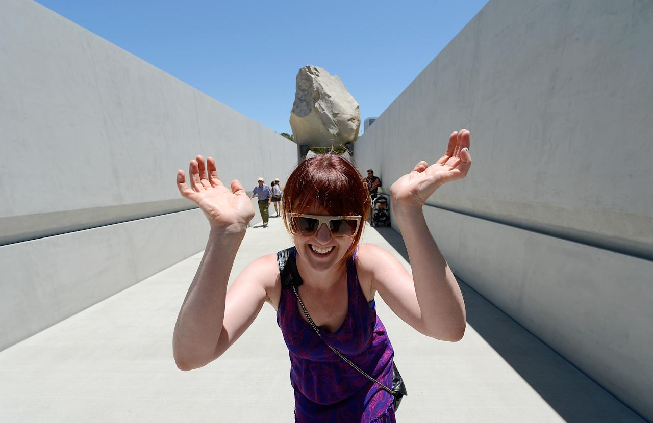 """Artist Michael Heizer's Huge Boulder, """"Levitated Mass"""", Goes On Display At L.A. County Museum Of Art"""