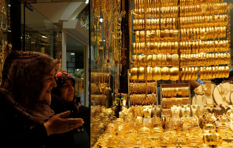 Gold eases as equities shrug off virus fears