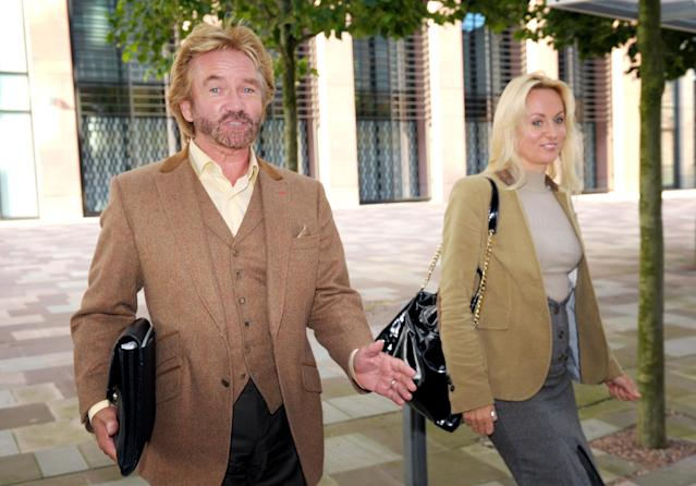 TV presenter Noel Edmonds and his wife Liz Davies, leave Bristol County Court, where Mr Edmonds is in a legal dispute with former business partner Ulrik Lawson. (Photo by Tim Ireland/PA Images via Getty Images)