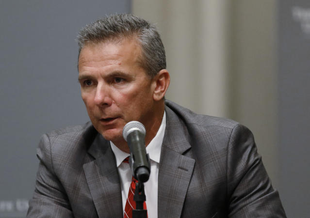 FILE - In this Aug. 22, 2018, file photo, Ohio State football coach Urban Meyer makes a statement during a news conference in Columbus, Ohio. Meyers current suspension and previous paid leave have restricted him from talking football with his staff and athletes during August with one exception _ a team meeting the day after the suspension was announced. Emails from the senior vice president for human resources show Meyer and athletic director Gene Smith were allowed to meet with the players and coaches last Thursday, Aug. 23, 2018. (AP Photo/Paul Vernon, File)