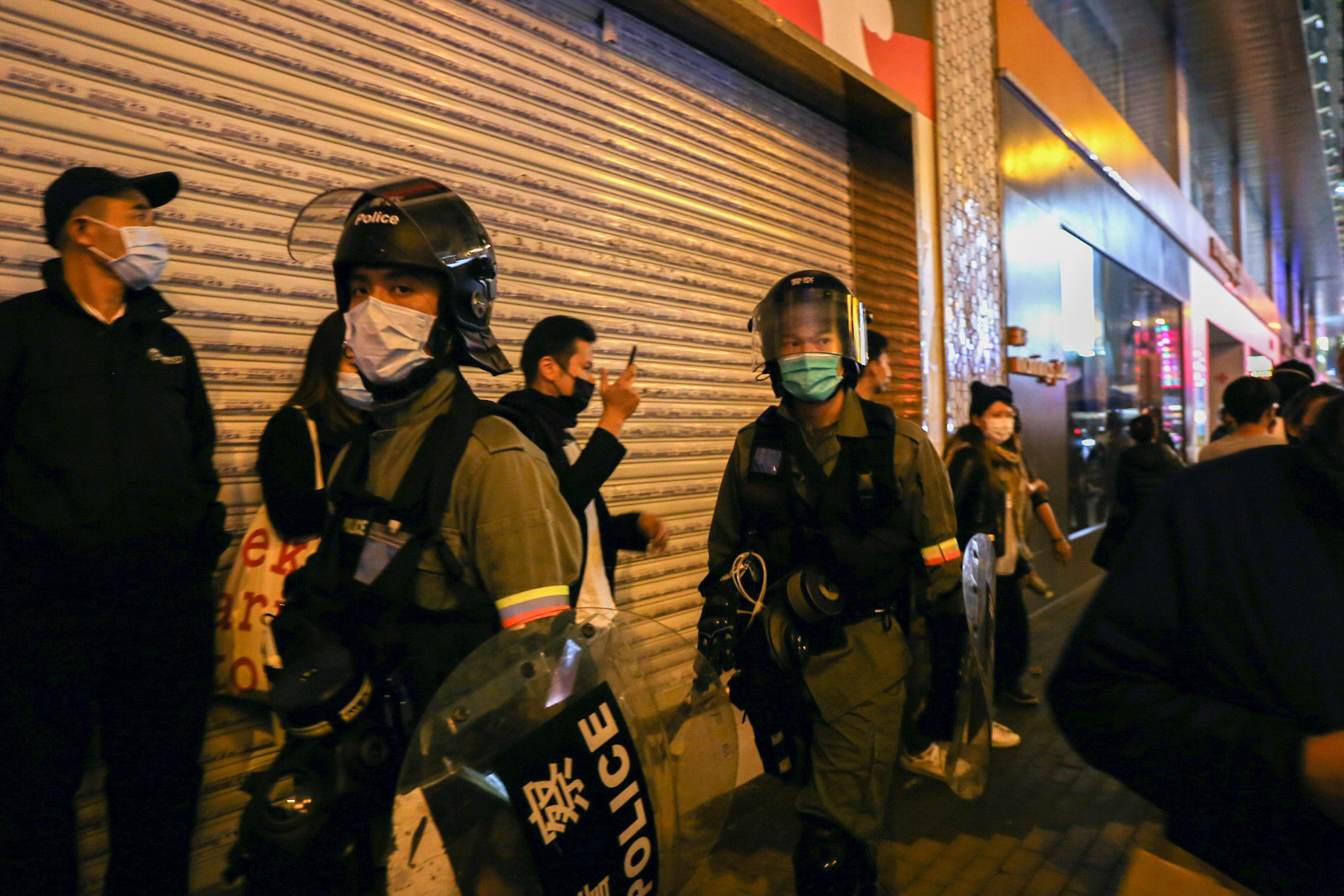 MONG KOK, HONG KONG, CHINA - 2020/01/26: Police during a dispersal mission of Hong Kong protestors wear face masks in addition to their protective gear following reports of the Wuhan Coronavirus appearing in Hong Kong. The Wuhan Coronavirus is a new and highly infectious SARS-strain virus that originated in the Hubei province of China, and has been traced back to an animal market in the city of Wuhan. (Photo by Katherine Cheng/SOPA Images/LightRocket via Getty Images)