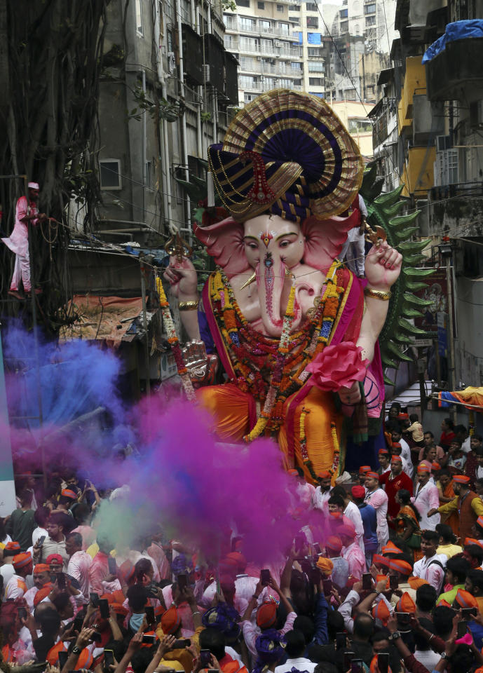 Giant idols of elephant-headed Hindu god Ganesha are taken for immersion in the Arabian Sea on the final day of the ten-day long Ganesh Chaturthi festival in Mumbai, India, Thursday, Sept. 12, 2019. The festival is a celebration of the birth of Ganesha, the Hindu god of wisdom, prosperity and good fortune. (AP Photo/Rajanish Kakade)