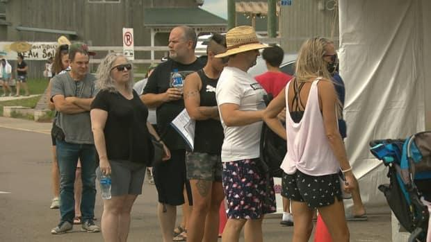 People lined up as soon as the Parlee Beach pop up vaccination clinic opened Friday afternoon. All people required was identification to get their first or second dose of Pfizer vaccine. (Pierre Fournier/CBC - image credit)