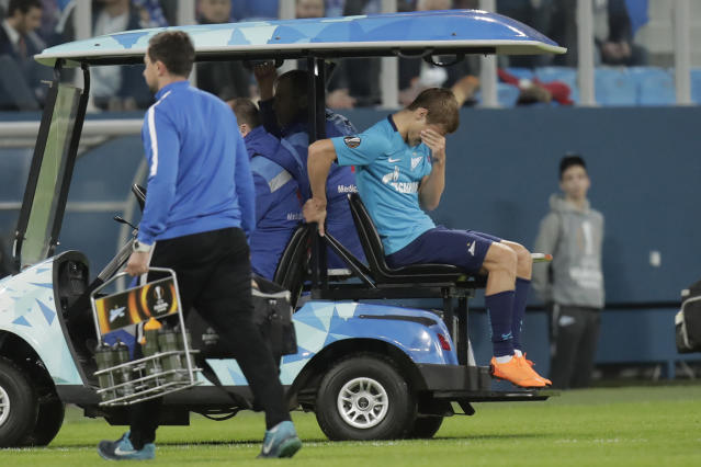 Zenit's Alexsander Kokorin leaves the field after getting injured during the Europa League round of sixteen second leg soccer match between Zenit St. Petersburg and Leipzig, at the Saint Petersburg stadium in St.Petersburg, Russia, Thursday, March 15, 2018. (AP Photo/Dmitri Lovetsky)