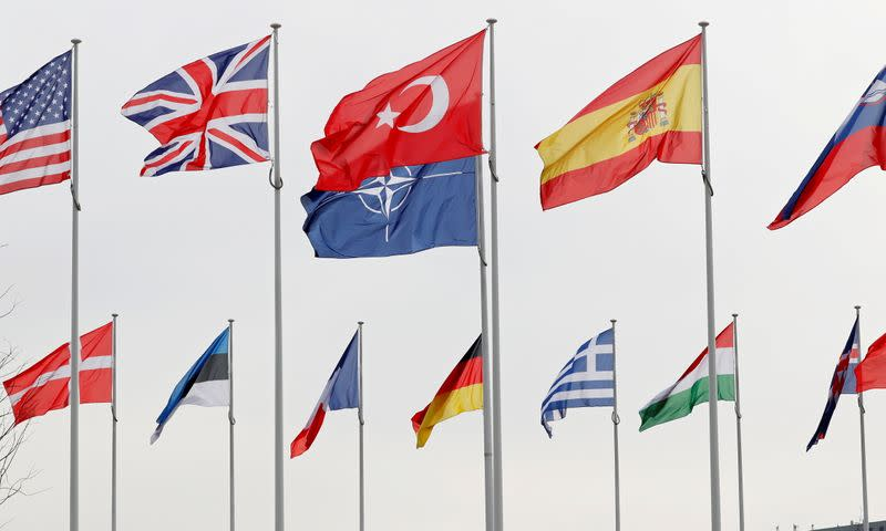 FILE PHOTO: Flags of NATO member countries flutter at the Alliance headquarters in Brussels