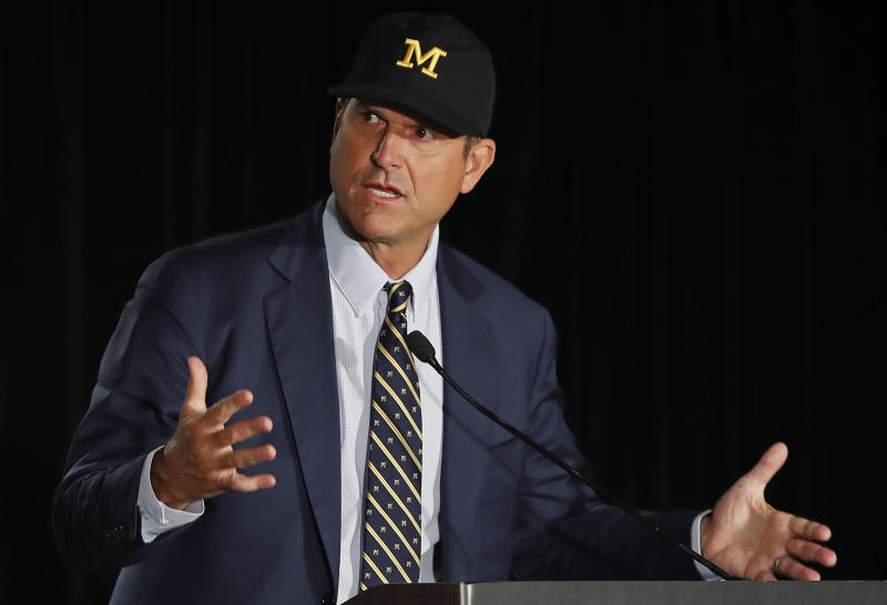 Jim Harbaugh cast doubt on claims of transfers who cite mental health when seeking an eligibility waiver. (Reuters)