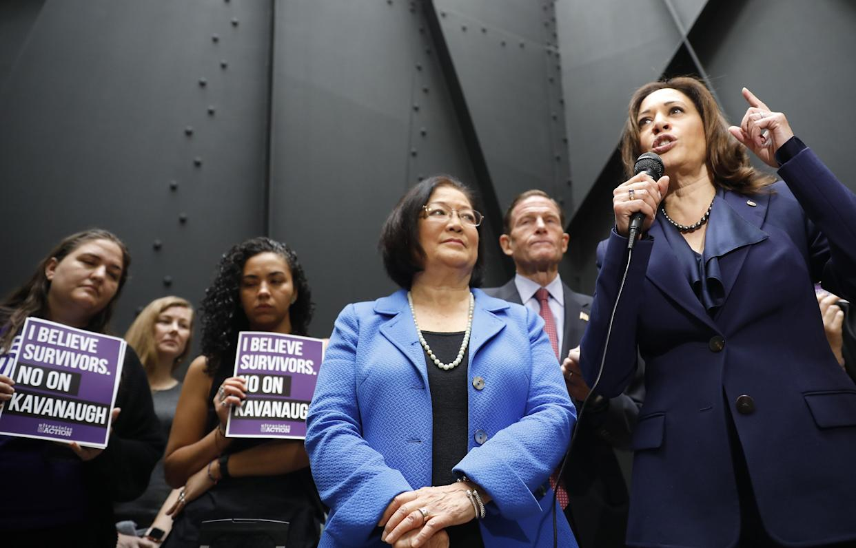 Senators Mazie Hirono (center) and Kamala Harris speak at a rally about Brett Kavanaugh's confirmation hearings and the sexual assault allegations against the judge. (Photo: Bloomberg via Getty Images)