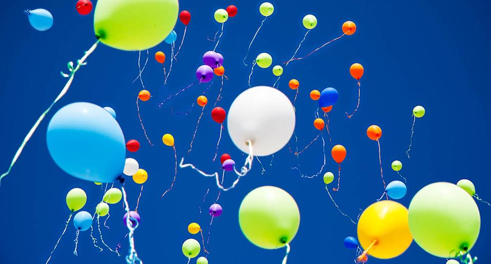 Colourful balloons being released into the sky