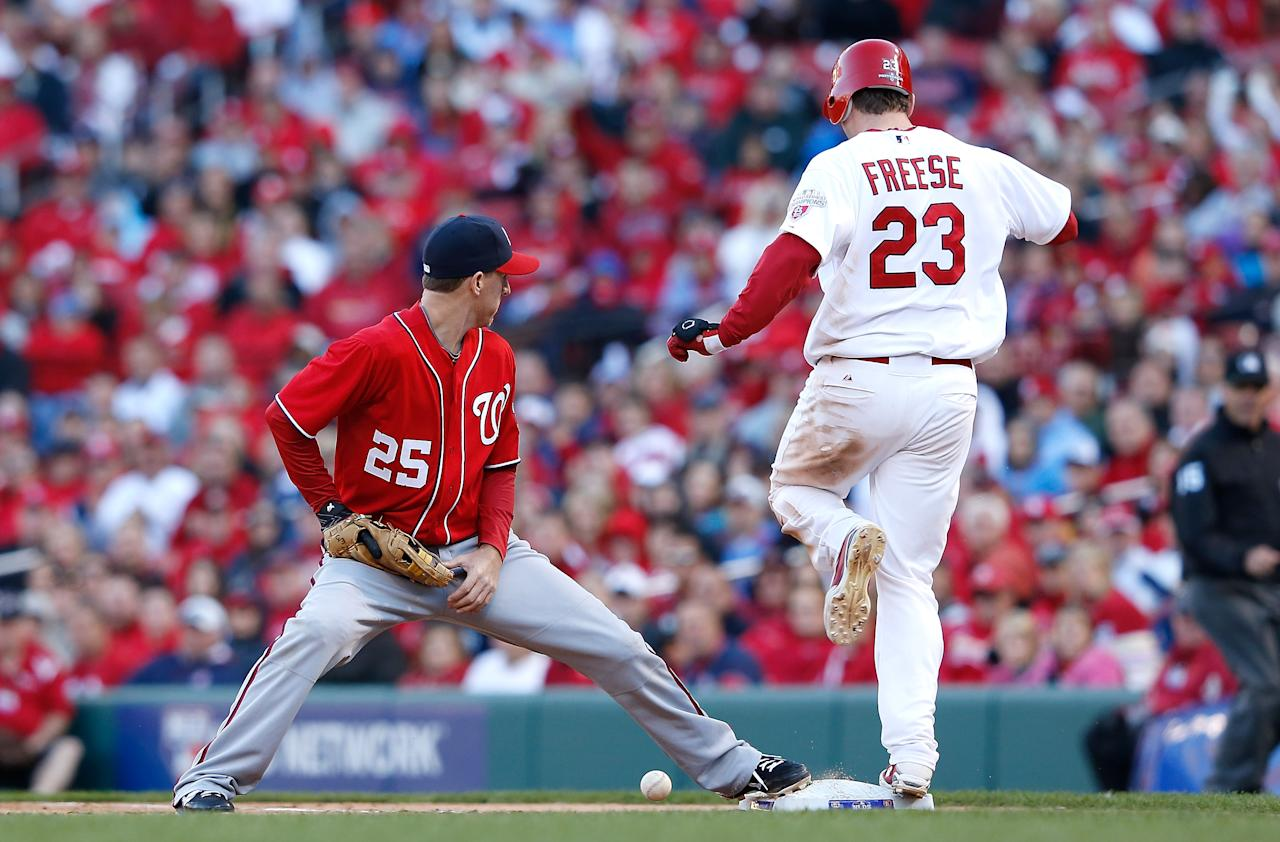 ST LOUIS, MO - OCTOBER 07:  Adam LaRoche #25 of the Washington Nationals bobbles the ball making David Freese #23 of the St Louis Cardinals safe during Game One of the National League Division Series at Busch Stadium on October 7, 2012 in St Louis, Missouri.  (Photo by Jamie Squire/Getty Images)