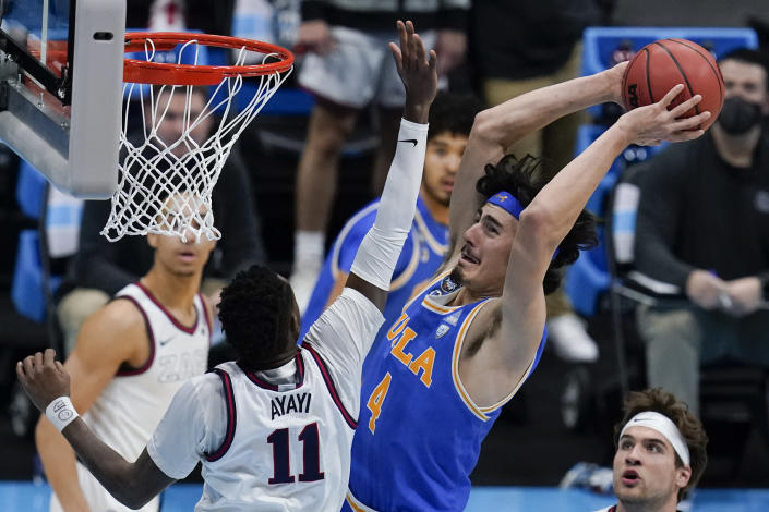 UCLA guard Jaime Jaquez Jr. (4) shoots over Gonzaga guard Joel Ayayi (11) during the first half of a men's Final Four NCAA college basketball tournament semifinal game, Saturday, April 3, 2021, at Lucas Oil Stadium in Indianapolis. (AP Photo/Michael Conroy)