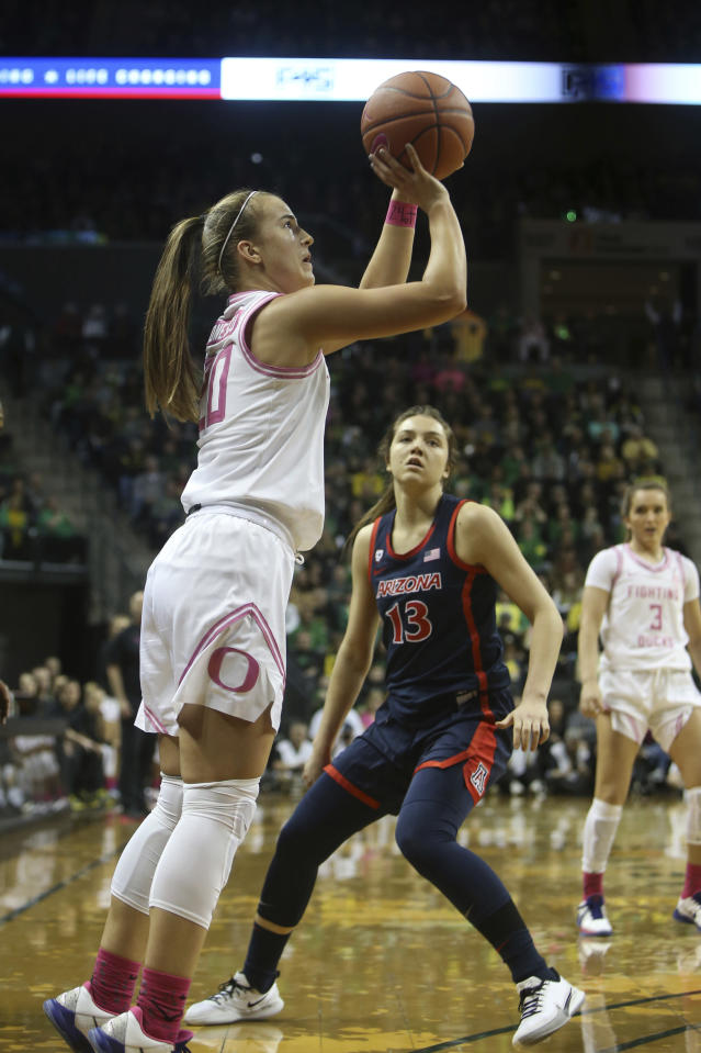 Oregon's Sabrina Ionescu, left, shpots past Arizona's Helena Pueyo during the first quarter of an NCAA college basketball game in Eugene, Ore., Friday, Feb. 7, 2020. (AP Photo/Chris Pietsch)