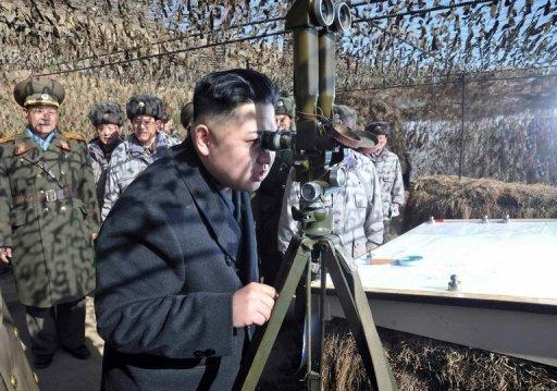 North Korean leader Kim Jong-Un (C) inspects military units under the command of the Korean Peoples' Army 4th Corps on February 27. North Korea's new leadership has agreed to suspend nuclear tests and its uranium enrichment programme as part of a deal that includes US food aid for the impoverished nation