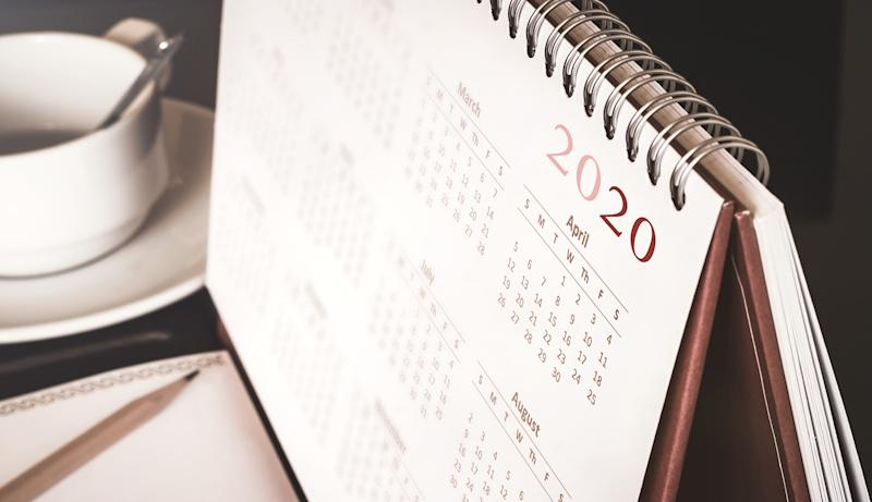 Desktop calendar sitting on desk showing year of 2020