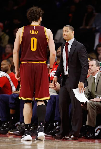 Tyronn Lue takes a moment to offer Kevin Love some motivational swear words. (Gregory Shamus/Getty Images)