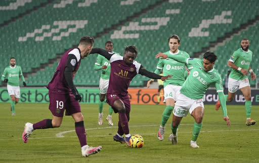 PSG's Moise Kean, center, in action during the French League One soccer match between Saint-Etienne and Paris Saint-Germain at the Geoffroy Guichard stadium, in Saint-Etienne, central France, Wednesday, Jan. 6, 2021. (AP Photo/Laurent Cipriani)