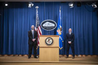 """Steven D'Antuono, head of the Federal Bureau of Investigation (FBI) Washington field office, left, and acting U.S. Attorney Michael Sherwin, stand during a news conference Tuesday, Jan. 12, 2021, in Washington. Federal prosecutors are looking at bringing """"significant"""" cases involving possible sedition and conspiracy charges in last week's riot at the U.S. Capitol. (Sarah Silbiger/Pool via AP)"""