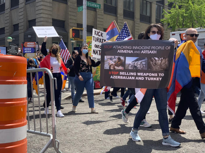 """Demonstrators march in a rally protesting against Armenian genocide on 23rd Street crossing over Broadway, Saturday, April 24, 2021, in New York. The United States is formally recognizing that the systematic killing and deportation of hundreds of thousands of Armenians by Ottoman Empire forces in the early 20th century was """"genocide"""" as President Joe Biden used that precise word that the White House has avoided for decades for fear of alienating ally Turkey. (AP Photo/Pamela Hassell)"""