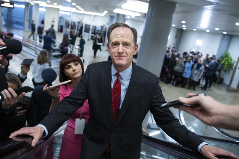 UNITED STATES - JANUARY 28: Sen. Pat Toomey, R-Pa., talks with reporters in the senate subway before the continuation of the impeachment trial of President Donald Trump on Tuesday, January 28, 2020. (Photo By Tom Williams/CQ-Roll Call, Inc via Getty Images)