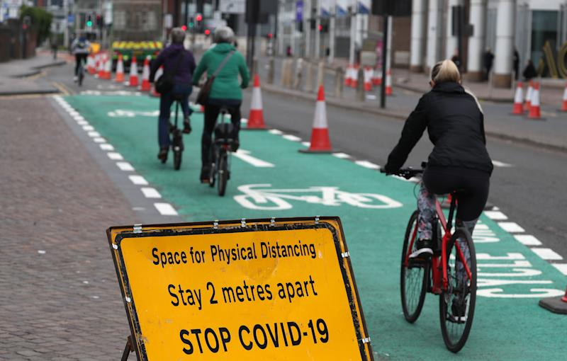 Cyclist pass social distancing signage in Glasgow as Scotland is moving into phase one of the Scottish Government's plan for gradually lifting lockdown.