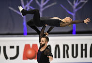 Ashley Cain-Gribble and Timothy LeDuc of the USA perform during the Pairs Short Program at the Figure Skating World Championships in Stockholm, Sweden, Wednesday, March 24, 2021. (AP Photo/Martin Meissner)