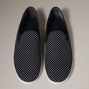 Dolce & Gabbana In case you were questioning how to elevate your black tux, a pretty tie alone isn't the answer. These hypnotizing polka dot slip-ons by Dolce & Gabbana are however, with their ability to bring that Hugh Hef pyjama effect to your formal wear.