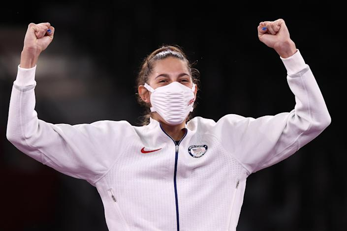 Gold medallist Anastasija Zolotic of the United States poses at a victory ceremony for the women's (Valery Sharifulin / TASS / Getty Images)