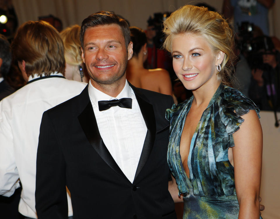 Ryan Seacrest and Julianne Hough pose on arrival at the Metropolitan Museum of Art Costume Institute Benefit celebrating the opening of Alexander McQueen: Savage Beauty, in New York, May 2, 2011. REUTERS/Mike Segar (UNITED STATES - Tags: ENTERTAINMENT FASHION)