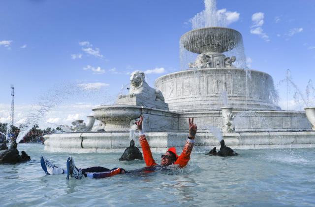 Scott Dixon, of New Zealand, celebrates by swimming in the James Scott Memorial Fountain after winning the second race of the IndyCar Detroit Grand Prix auto racing doubleheader in Detroit, Sunday, June 2, 2019. (AP Photo/Paul Sancya)