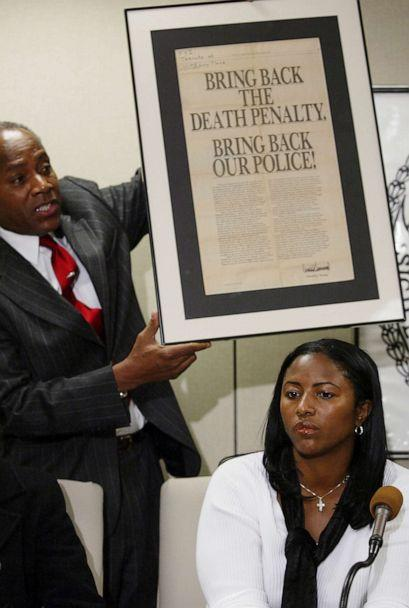 PHOTO: On Dec. 19, 2002, Angela Cuffie meets reporters at Manhattan Supreme Court and Councilman Bill Perkin s holds up an advertisement taken out by Donald Trump after the crime. (Mike Albans/New York Daily News via Getty Images, FILE)