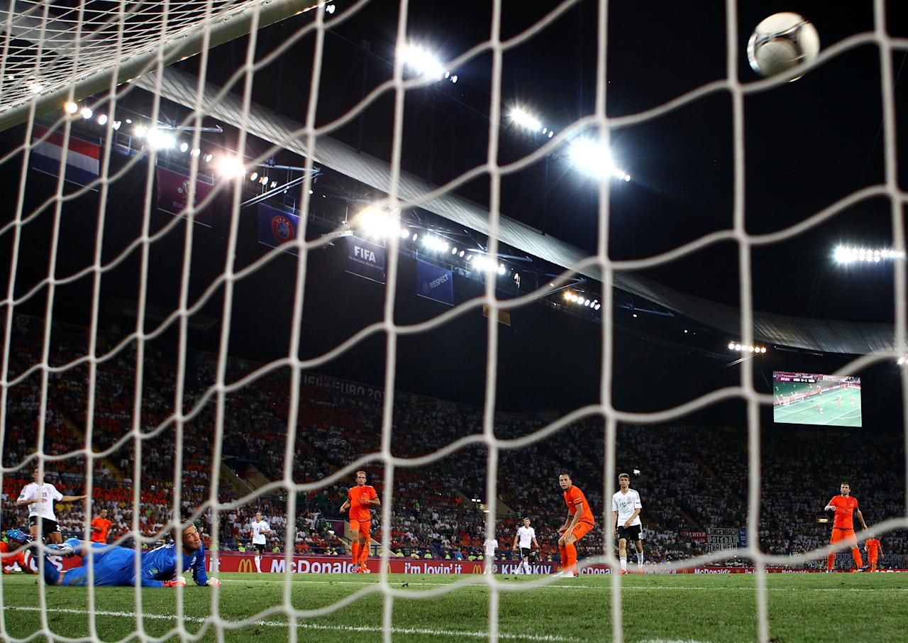 KHARKOV, UKRAINE - JUNE 13:  Mario Gomez of Germany scores their second goal past Maarten Stekelenburg of Netherlands during the UEFA EURO 2012 group B match between Netherlands and Germany at Metalist Stadium on June 13, 2012 in Kharkov, Ukraine.  (Photo by Julian Finney/Getty Images)