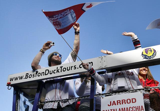 Boston Red Sox catcher Jarrod Saltalamacchia takes pictures as he rides in a duck boat during a rolling rally in Boston, Saturday, Nov. 2, 2013 to celebrate their World Series championship. (AP Photo/Elise Amendola)