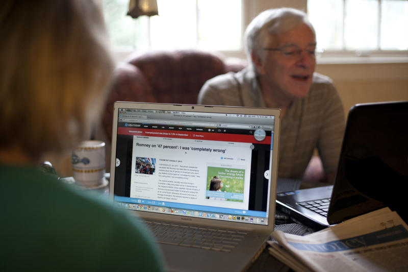 "In this photo taken Oct. 5, 2012, independent voters Thyra and Joe Galli read up on political news on Internet and with print newspapers at their home in Portsmouth, N.H. Thyra plans to vote for Obama and Joe is supporting Romney. New Hampshire's nickname is ""the Granite State"" but there's nothing solid about its political landscape. Independent voters have been the reason in recent presidential elections. Today, former factory towns to the south _ Manchester and Nashua _ typically vote Republican as do the rural small towns up north, while state capital Concord and university towns like Durham, Dover, Keene and Hanover tend to lean Democratic. And the entire state is peppered with independents like Joe and Thyra Galli of Portsmouth. (AP Photo/Robert F. Bukaty)"