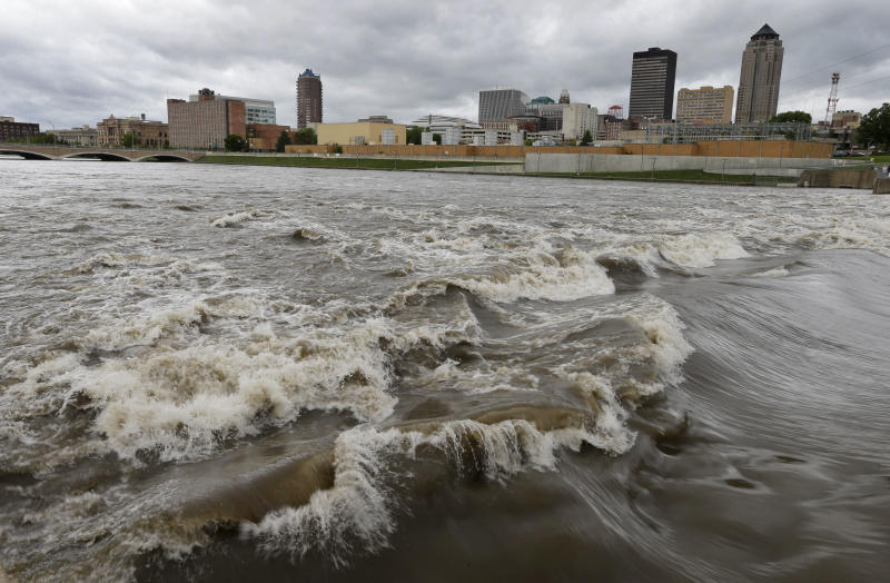 Water splashes over the Center Street Dam in the swollen Des Moines River, Thursday, May 30, 2013, in downtown Des Moines, Iowa. Heavy rains expected Thursday night and Friday morning could lead to more flooding in the state. (AP Photo/Charlie Neibergall)
