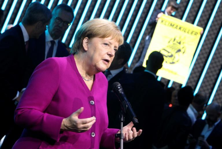 With her car-loving nation poised to miss 2020 carbon reduction targets, Merkel says Germany must act -- while so far resisting a broad carbon tax (AFP Photo/Daniel ROLAND)