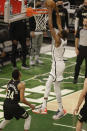 Brooklyn Nets forward Kevin Durant (7) dunks in front of Milwaukee Bucks forward Giannis Antetokounmpo (34) during the first half of Game 6 of a second-round NBA basketball playoff series Thursday, June 17, 2021, in Milwaukee. (AP Photo/Jeffrey Phelps)