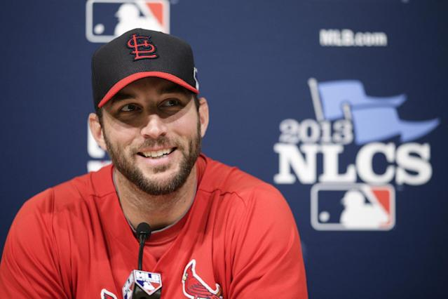 St. Louis Cardinals starting pitcher Adam Wainwright smiles while talking to reporters during practice in preparation for Monday's Game 3 of the National League baseball championship series against the Los Angeles Dodgers, on Sunday, Oct. 13, 2013, in Los Angeles. (AP Photo/Jae C. Hong)