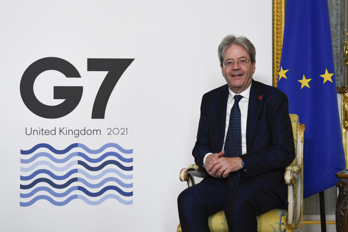 EU's Economy Commissioner Paolo Gentiloni poses for photographs as finance ministers from across the G7 nations meet at Lancaster House in London, Saturday, June 5, 2021, ahead of the G7 leaders' summit. (AP Photo/Alberto Pezzali, Pool)