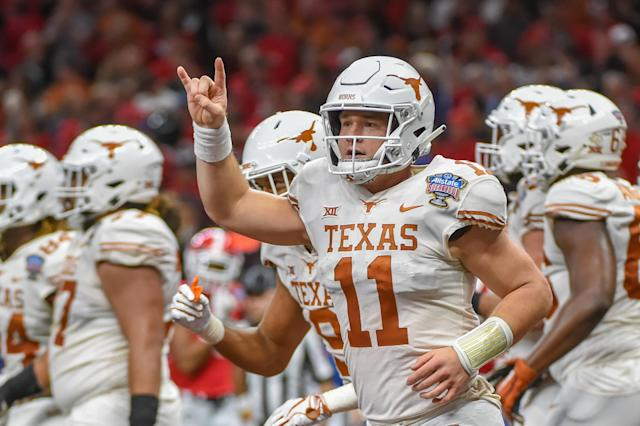 Texas takes the Hook 'Em Horns sign very seriously. (Photo by Ken Murray/Icon Sportswire via Getty Images)