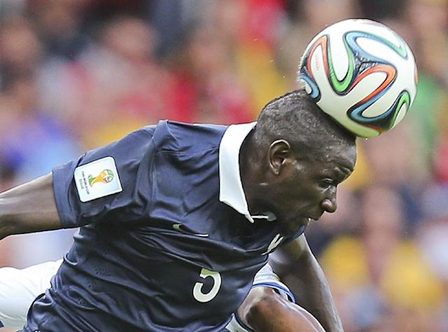 France's Mamadou Sakho heads the ball during the group E World Cup soccer match between France and Honduras at the Estadio Beira-Rio in Porto Alegre, Brazil, Sunday, June 15, 2014. (AP Photo/David Vincent)